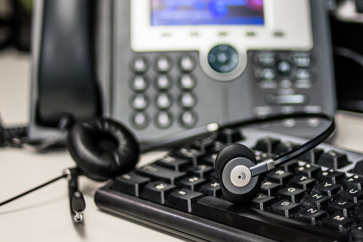 Desk phone and computer keyboard